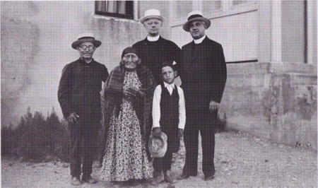 Eugene Buechel, Fathers Kiefer, S.J., and Dube, and Brother Hinderhofer, Mrs. Lightning, and little boy